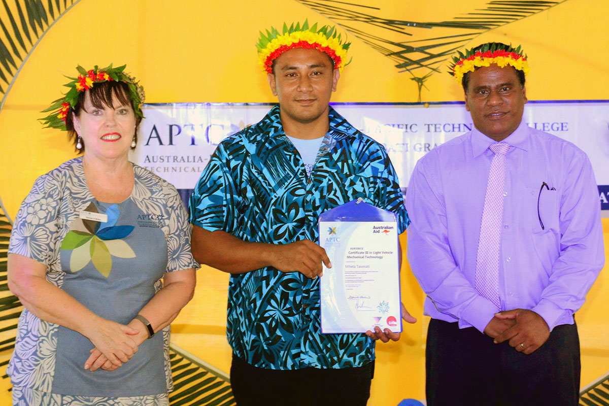 APTC CEO, Ms Denise O'Brien, Certificate III in Light Vehicle Mechanical Technology graduate, Mr Miteta Taomati and Kiribati Minister for Labour and Human Resources Development, Honourable Mr Ruateki Tekaiara