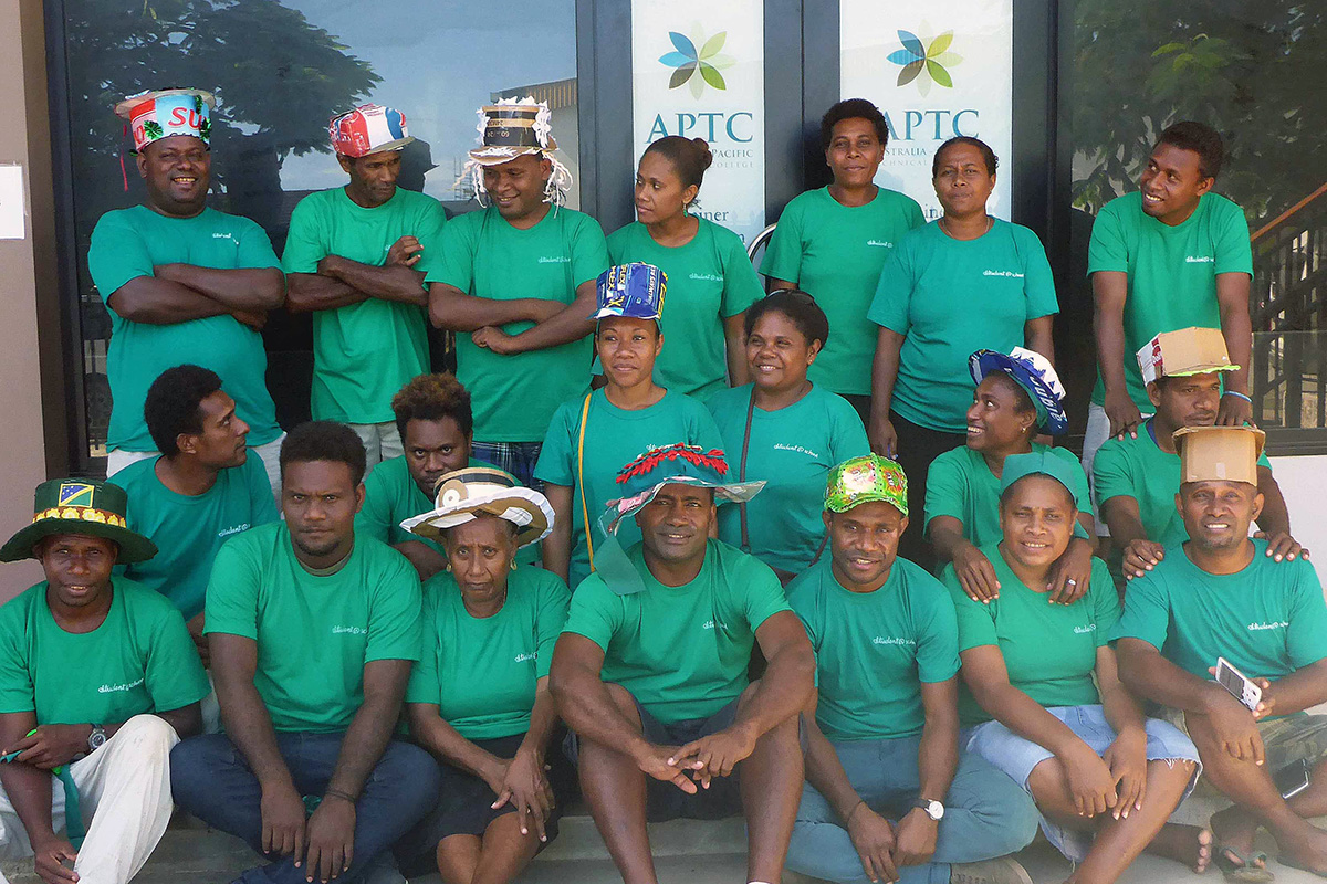 APTC Community Services students in Honiara, in their green outfits and hats.