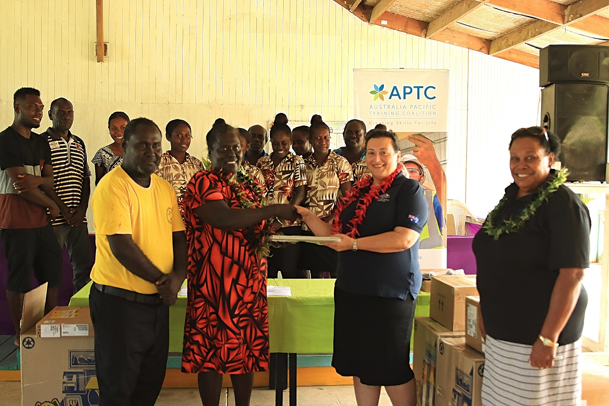 Second Secretary at the Australian High Commission in Solomon Islands, Christina Skoumbourdis, hands over laptops to Tabaka RTC staff and students